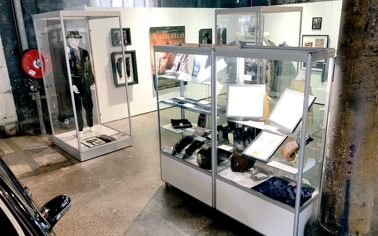 Display cabinets containing film props