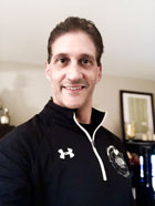 Robert Genovesi headshot smiling in athletic pullover