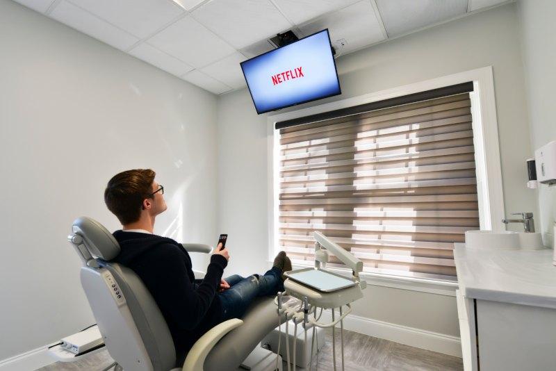 patient watching Netflix in examination room