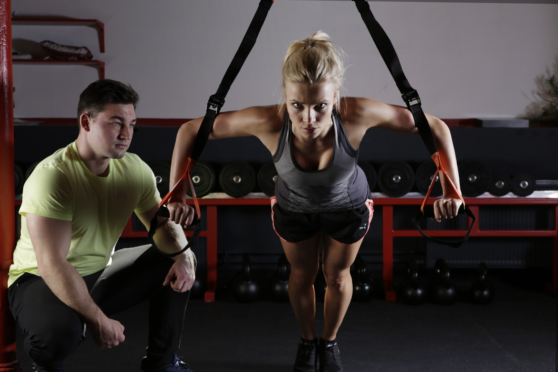 A personal trainer working with client