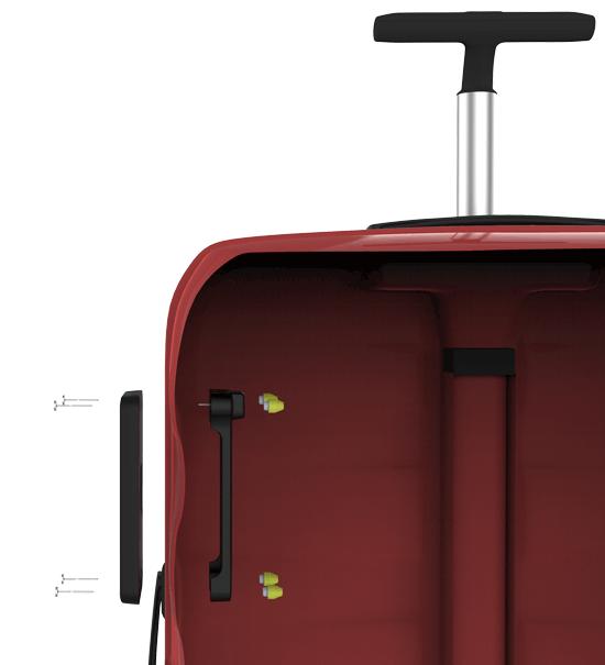Festeplaten til bagID GO festest i en rød koffert
