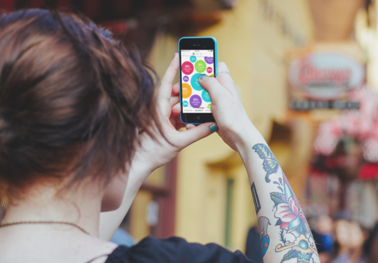 Girl holding a smartphone displaying the regiodeal.ch app