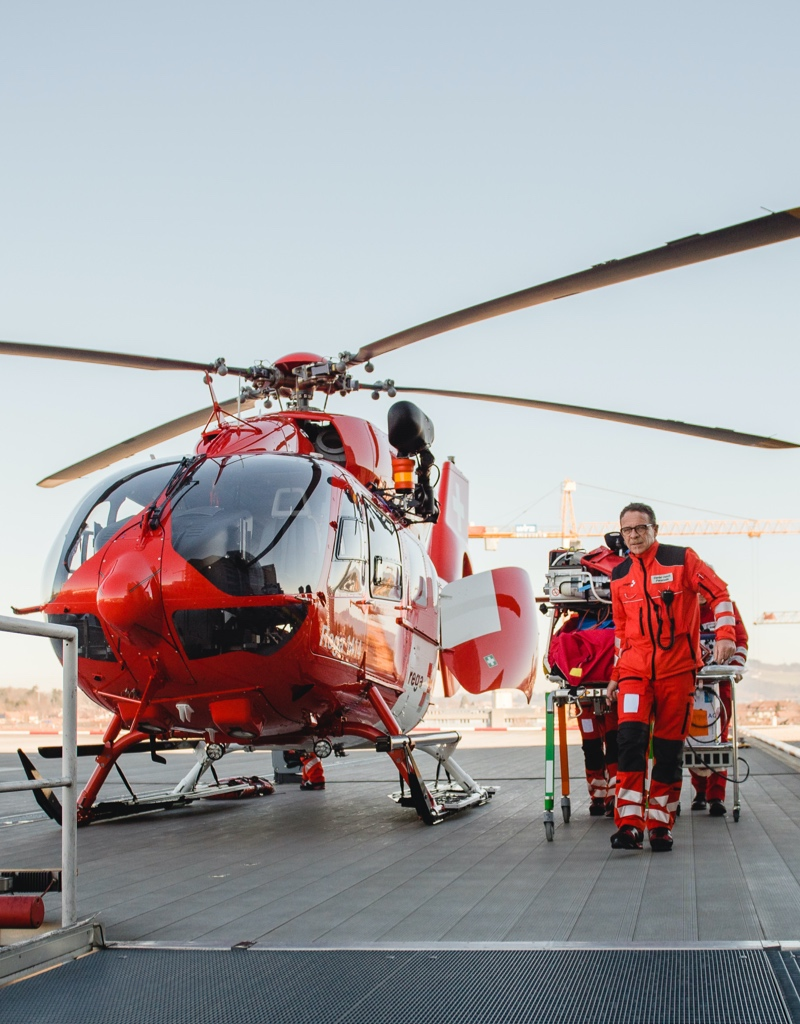 A rescue helicopter and medical personel.
