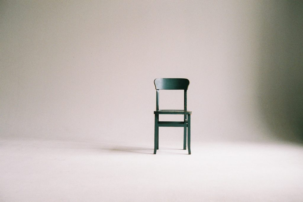 green-wooden-chair-on-white-surface-963486