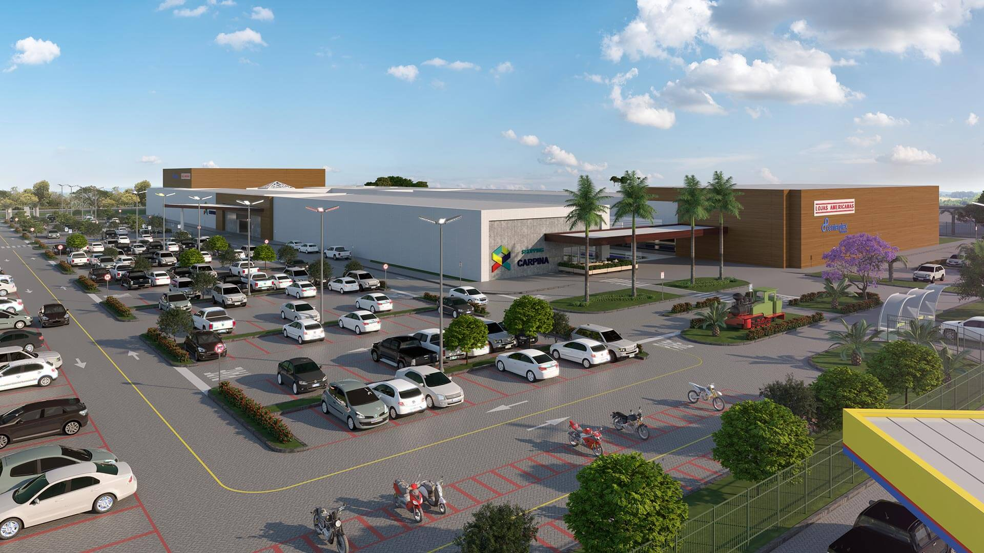 Vista aérea panorâmica do Shopping Carpina, com estacionamento cheio