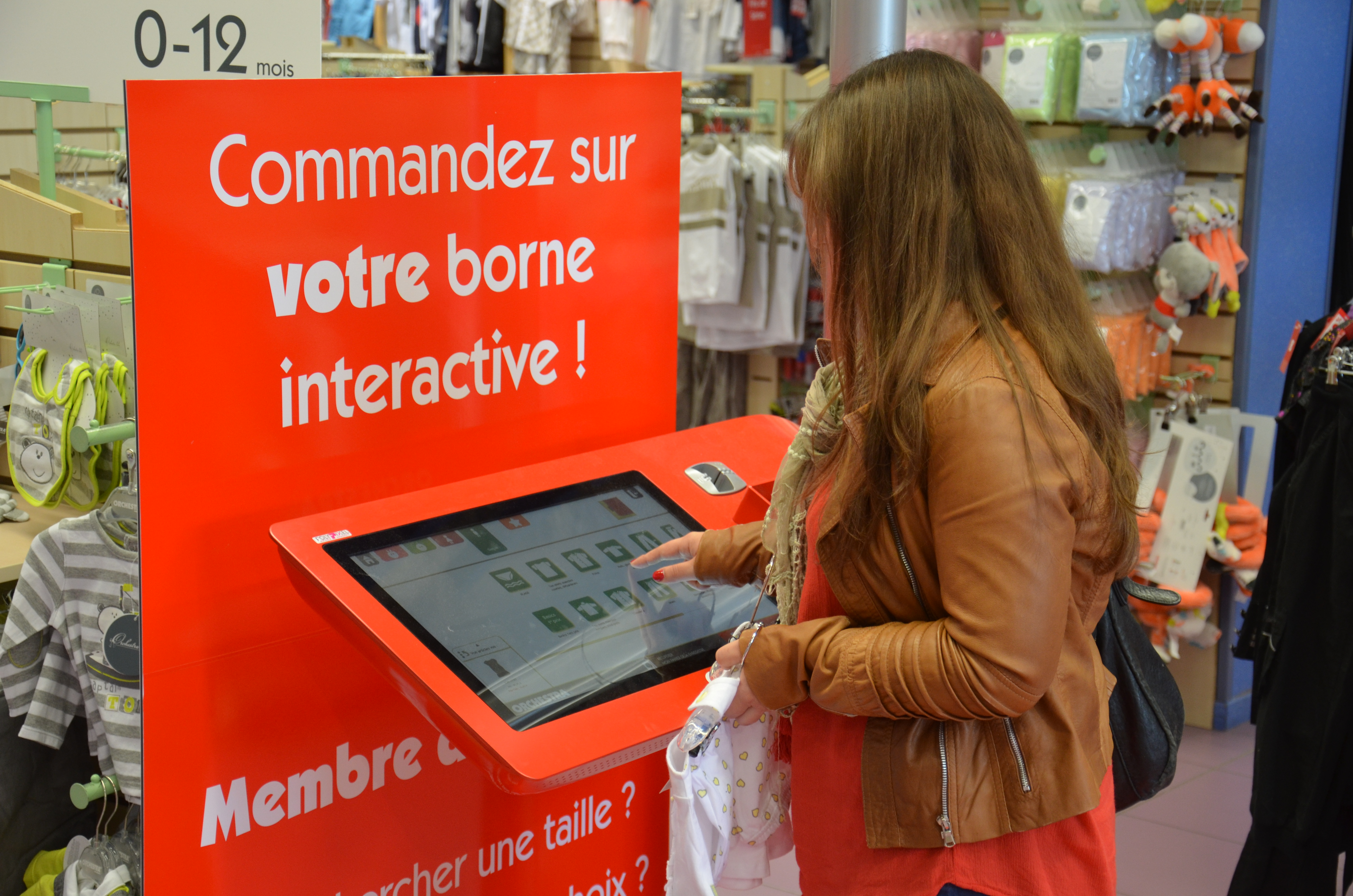 A mother in-store using an Interactive Kiosk
