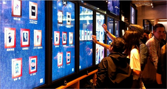 Users interacting with different touchscreens