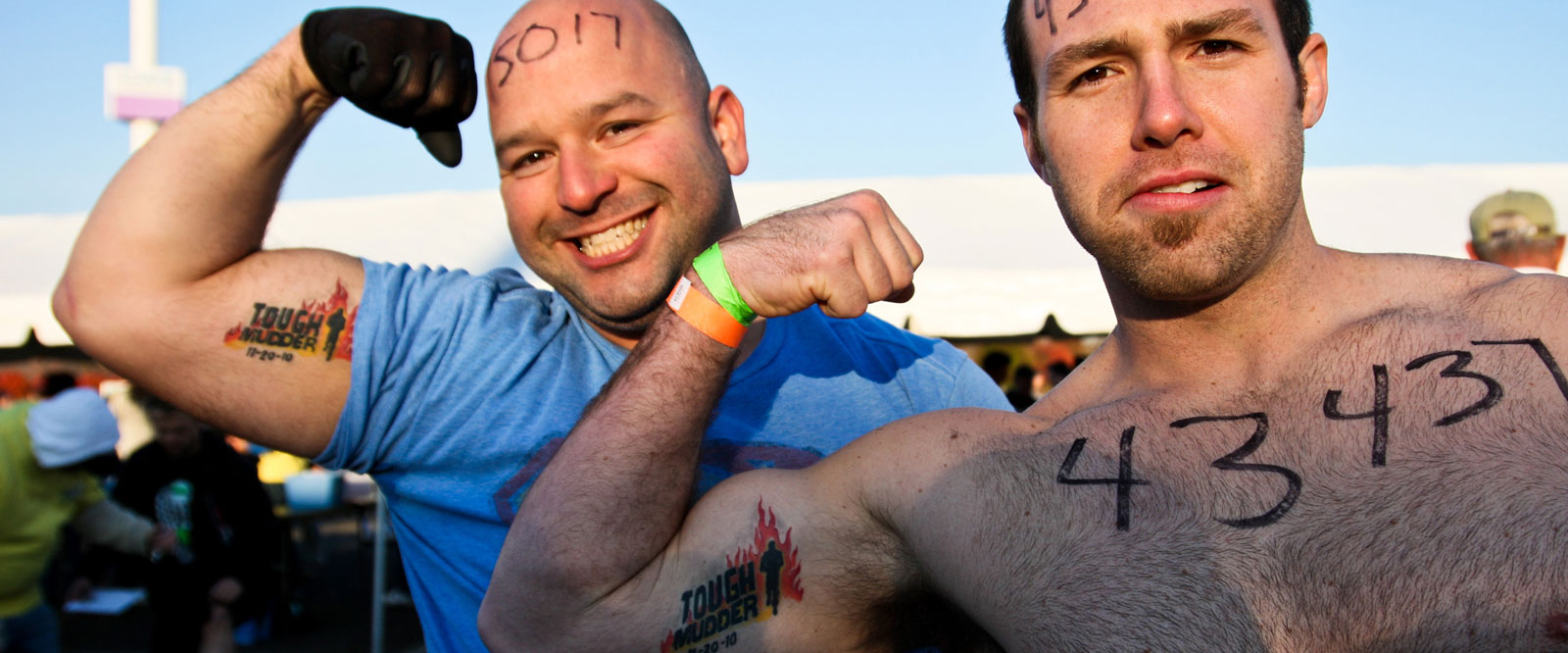 Two built dudes with Tough Mudder tattoos - brand by Condensed