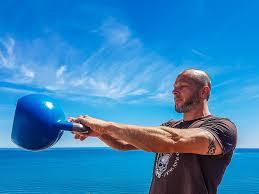 Man swinging a kettlebell