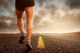 Man running down a highway