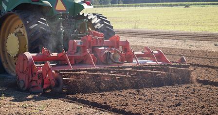 tractor disturbing soil