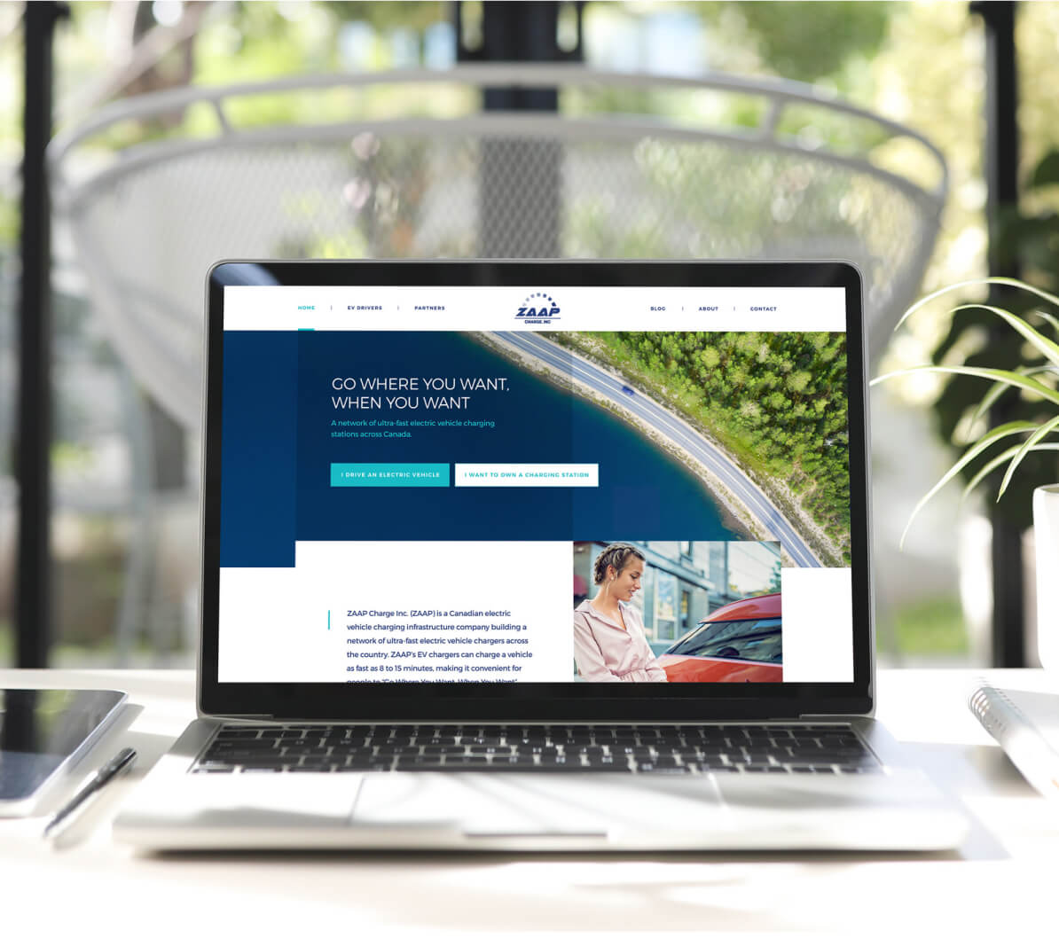 Zaap website landing page  laptop standing on a white desk