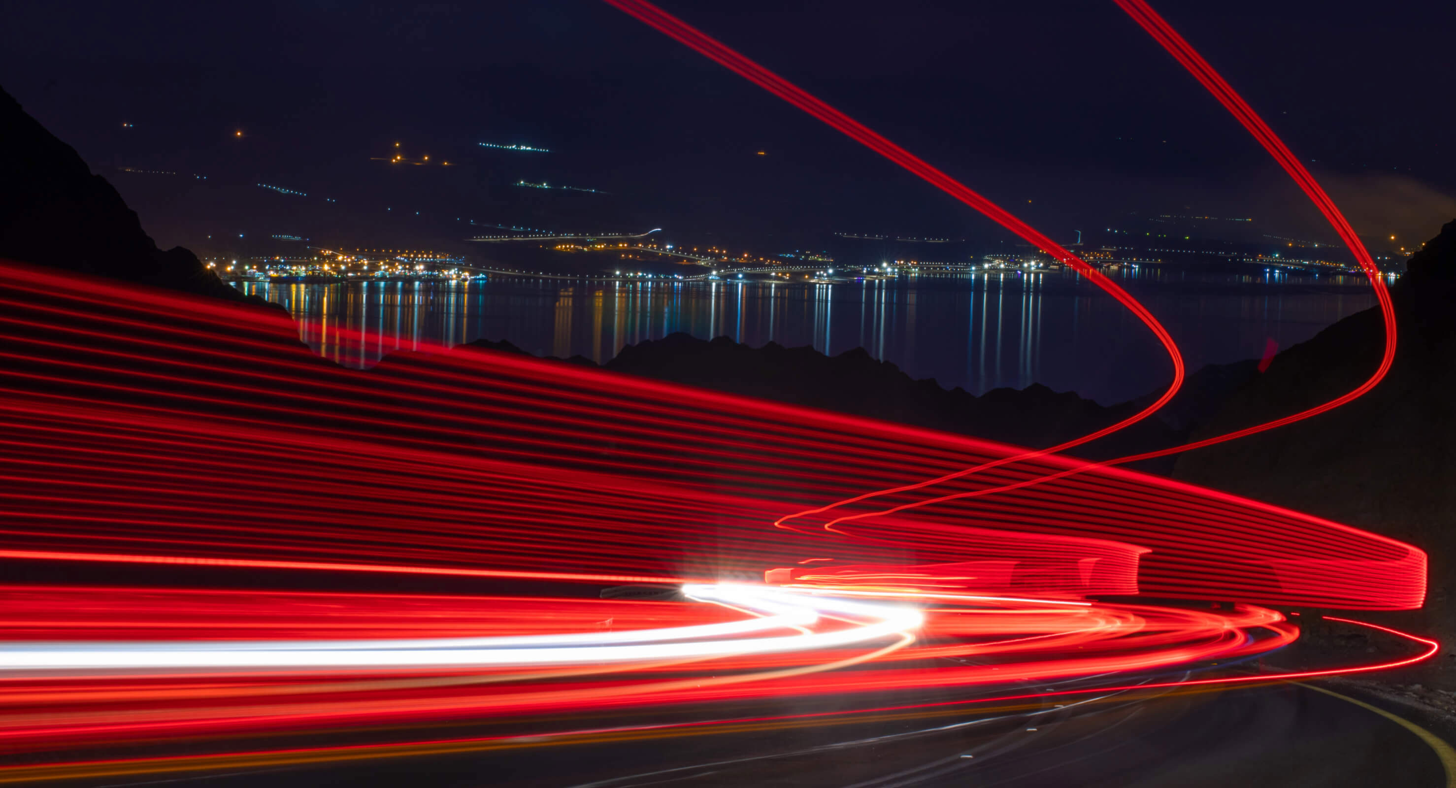 Dynamic red lines over city night landscape
