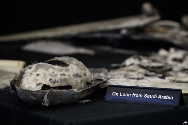 """Debris from a UAV (Qasef) is displayed with a sign that reads """"On Loan From Saudi Arabia"""" at the Iranian Materiel Display (IMD) at Joint Base Anacostia-Bolling, in Washington, Nov. 29, 2018. The presentation displays weapons and fragments of weapons seized in Afghanistan, Bahrain and Yemen that it said are evidence Iran is a """"grave and escalating threat"""" that must be stopped."""