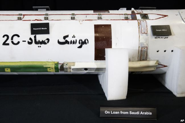 """Fragments of a Surface to Air Missile (Sayyad 2C) is displayed with a sign that reads """"On Loan From Saudi Arabia"""" at the Iranian Materiel Display (IMD) at Joint Base Anacostia-Bolling, in Washington, Nov. 29, 2018."""