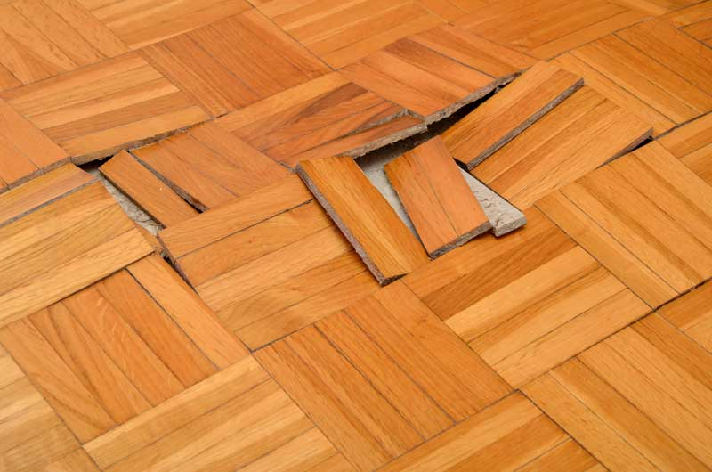 Water damaged buckled floors