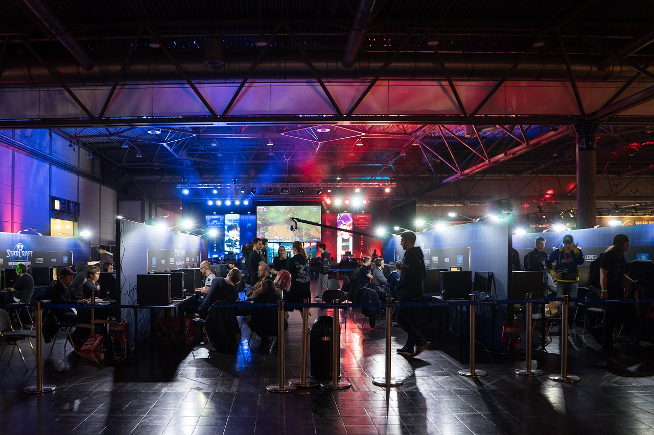 A PC gaming competition takes place with numerous players and spectators