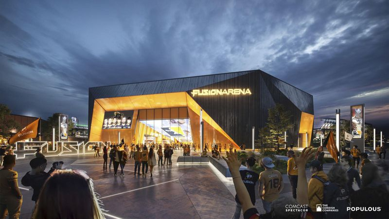 People stand outside a Fusion Arena, a black and yellow building.