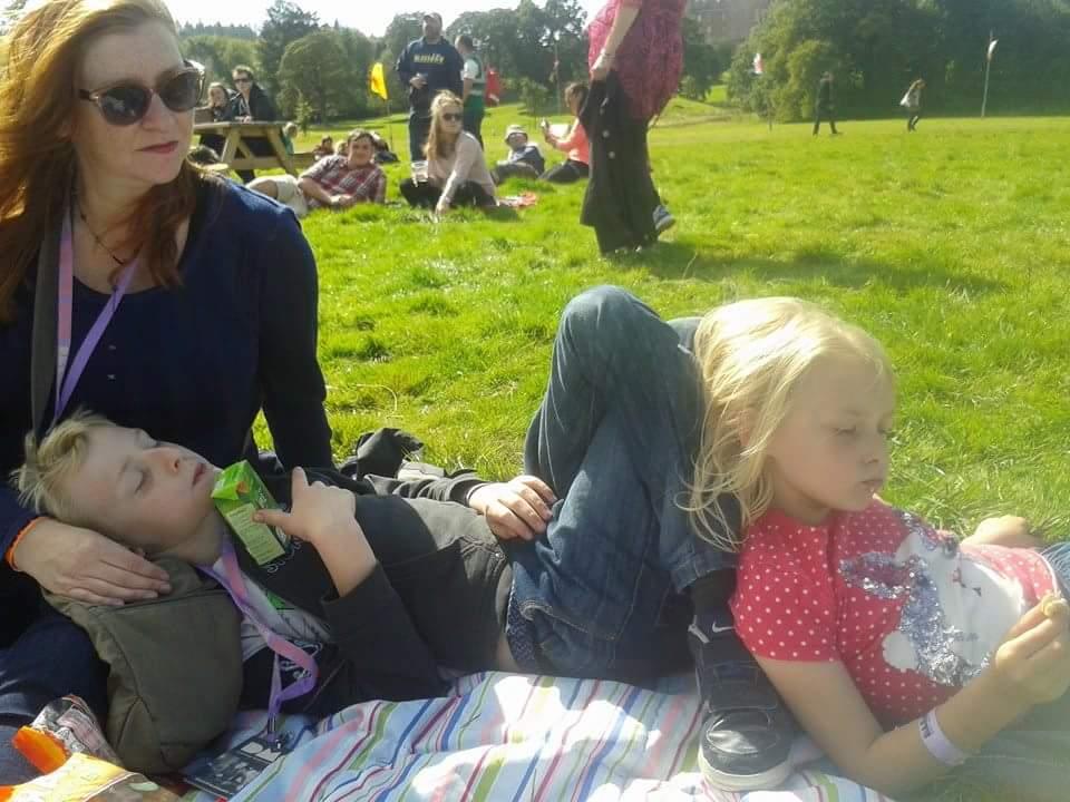 Tara and the kids kicking back at a festival
