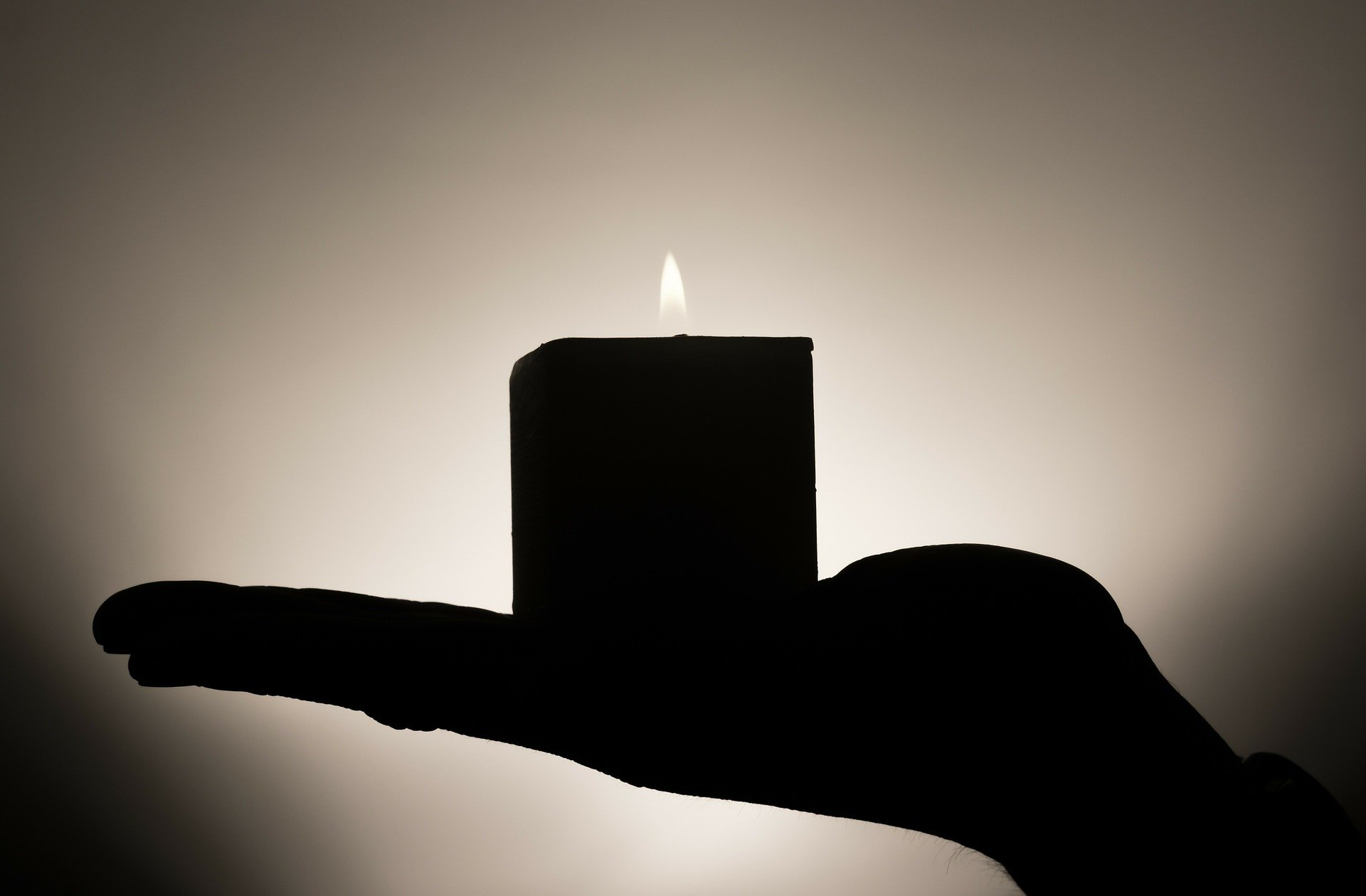 Hand holding candle. https://pixabay.com/photos/candle-hand-candlelight-flame-335965/
