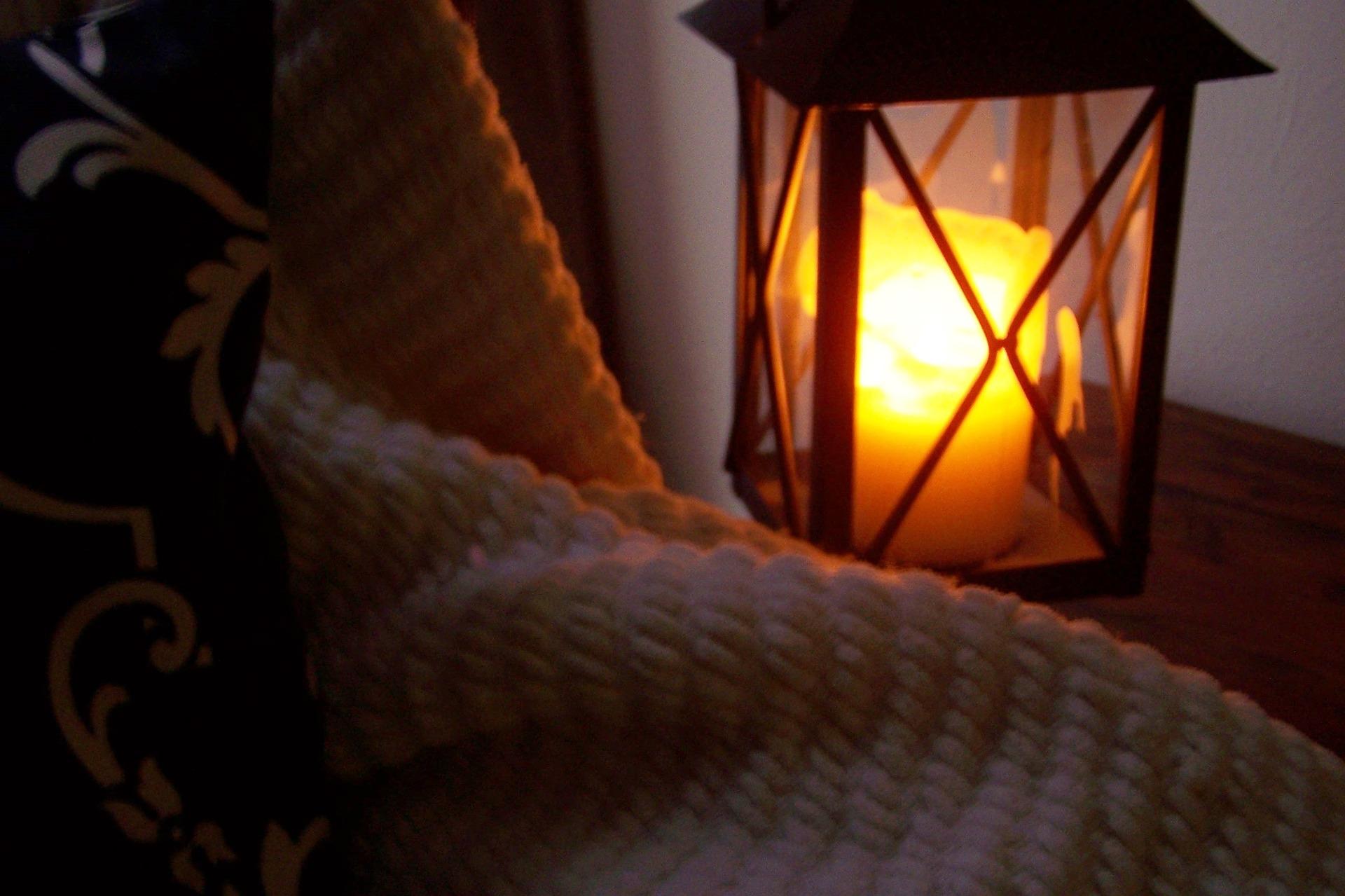 warm lit Lantern https://pixabay.com/photos/lantern-candle-blanket-cozy-827784/