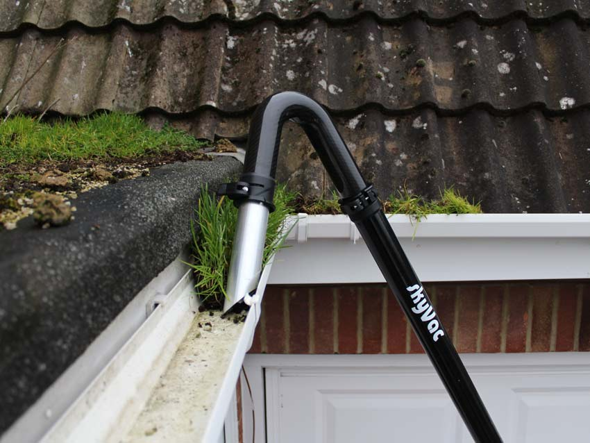 Gutter cleaning Vac System in operation cleaning a gutter