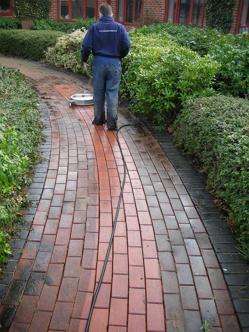 Paved pathway cleaning in progress