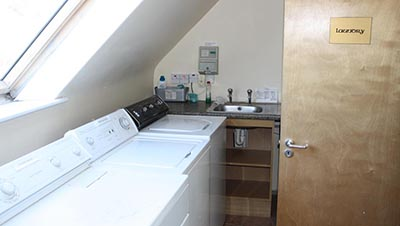 The laundry room at Barr na Sraide. Any of our guests can use these facilities to wash and dry their clothes