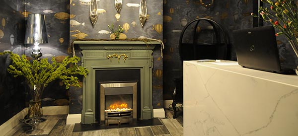 Reception area of Barr na Sraide B&B with a warm fire and luxury surroundings