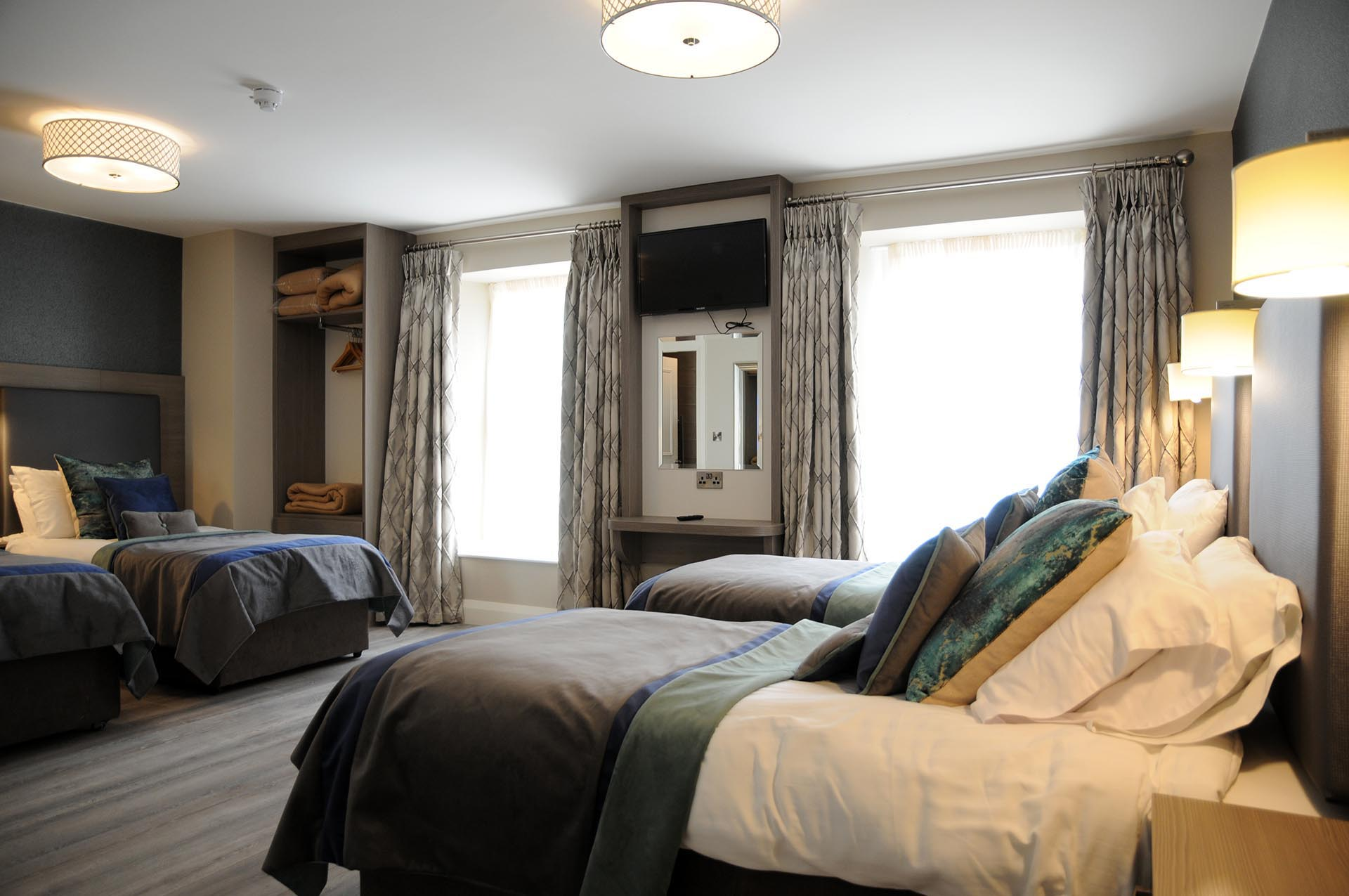 Four single beds in a 4 Bed Family Room at Barr na Sraide's B&B accommodation in Dingle Ireland