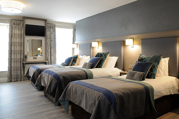 One double bed and one single bed in a Family Room at Barr na Sraide's family hotel accommodation in Dingle, co Kerry, Ireland