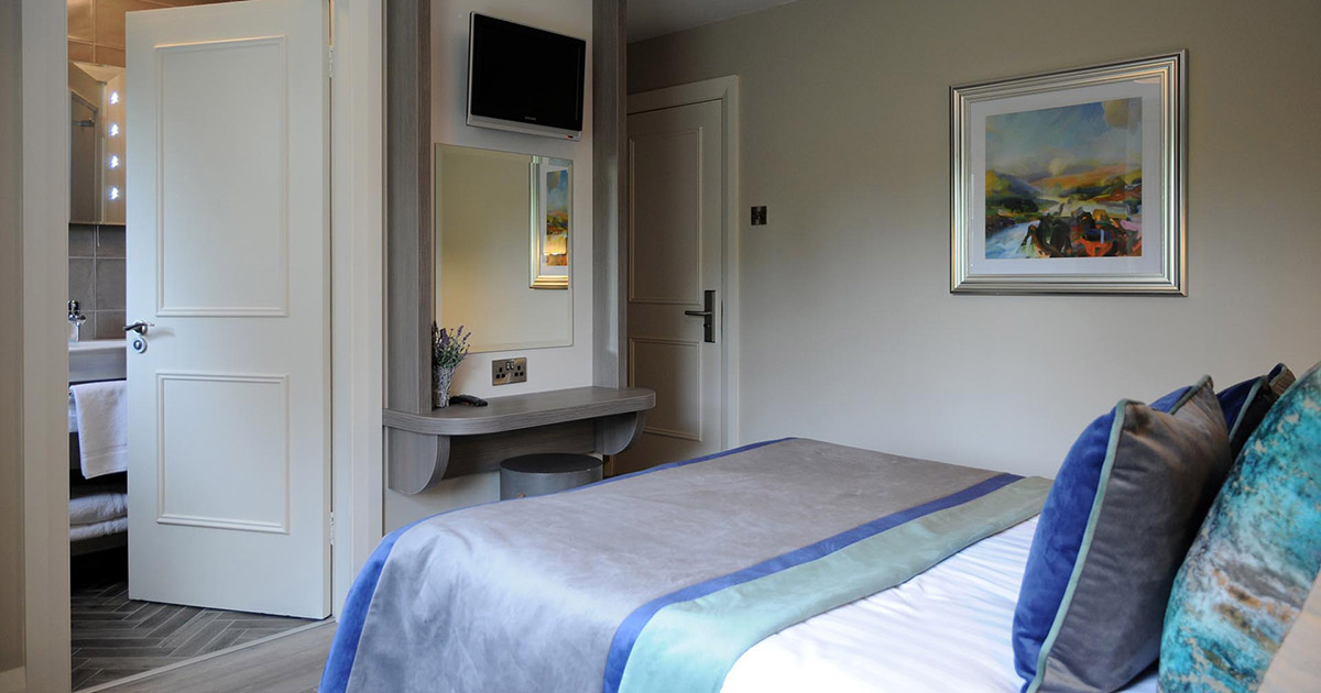 Three single beds and one double bed in a 5 Bed Family Room at Barr na Sraide's B&B accommodation in Dingle Ireland