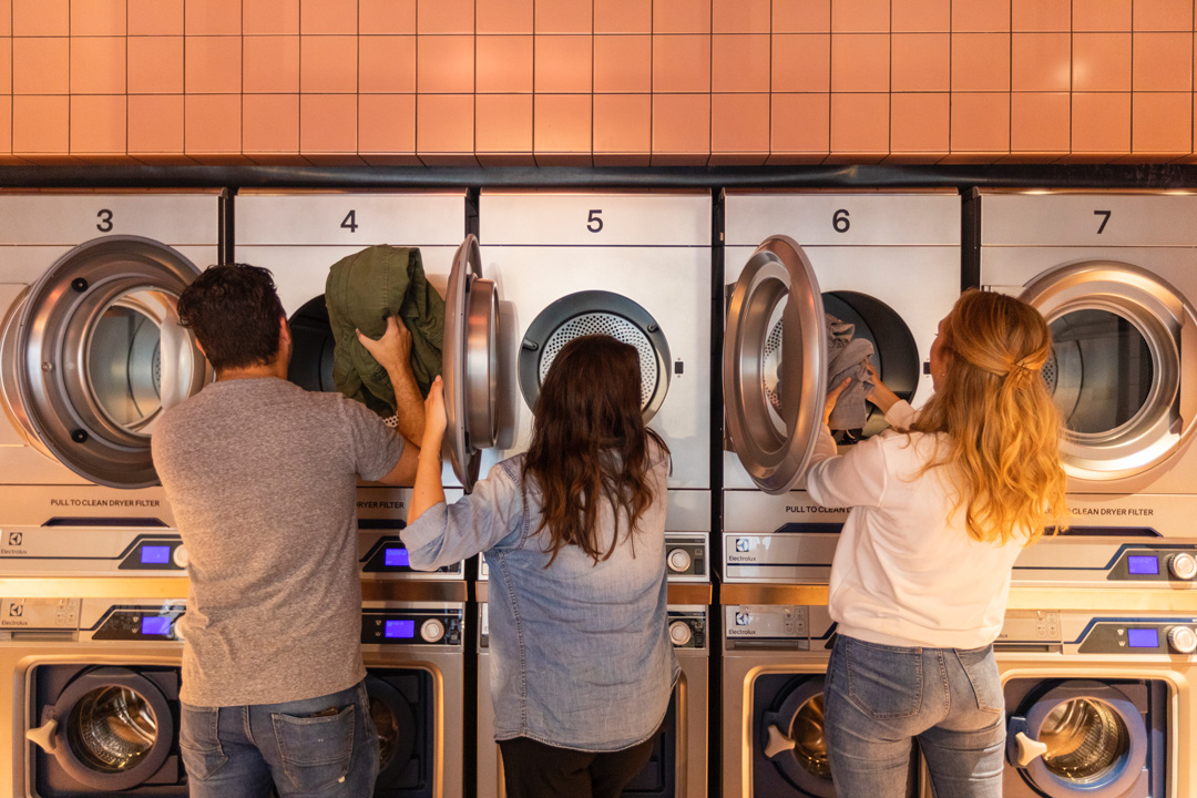 Residents doing the laundry at OurDomain Amsterdam South East