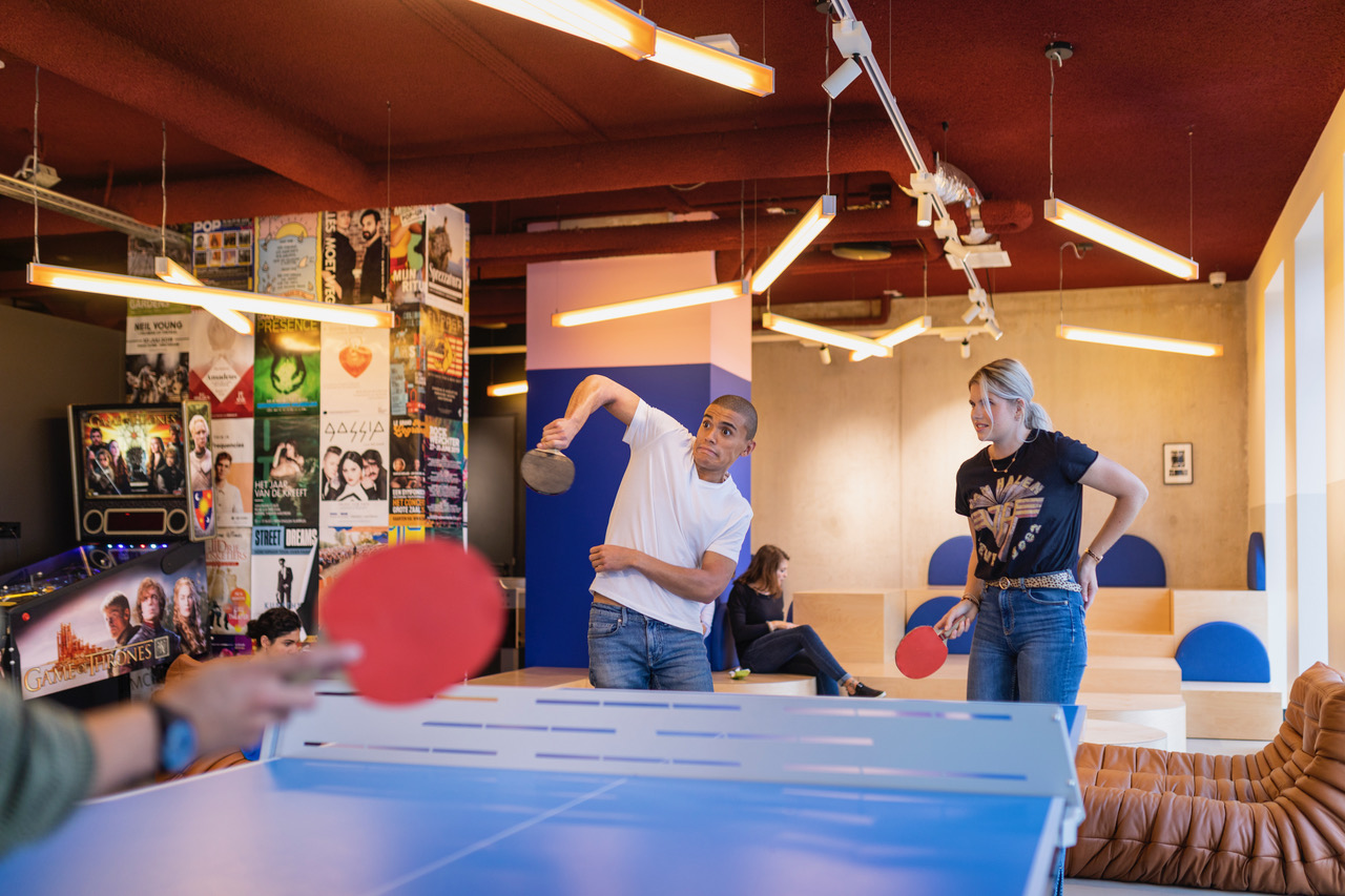 OurDomain facilities: residents playing tennis table in the game room