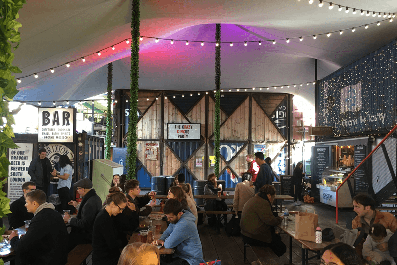 Pop Brixton Interior with guests sitting on communal tables