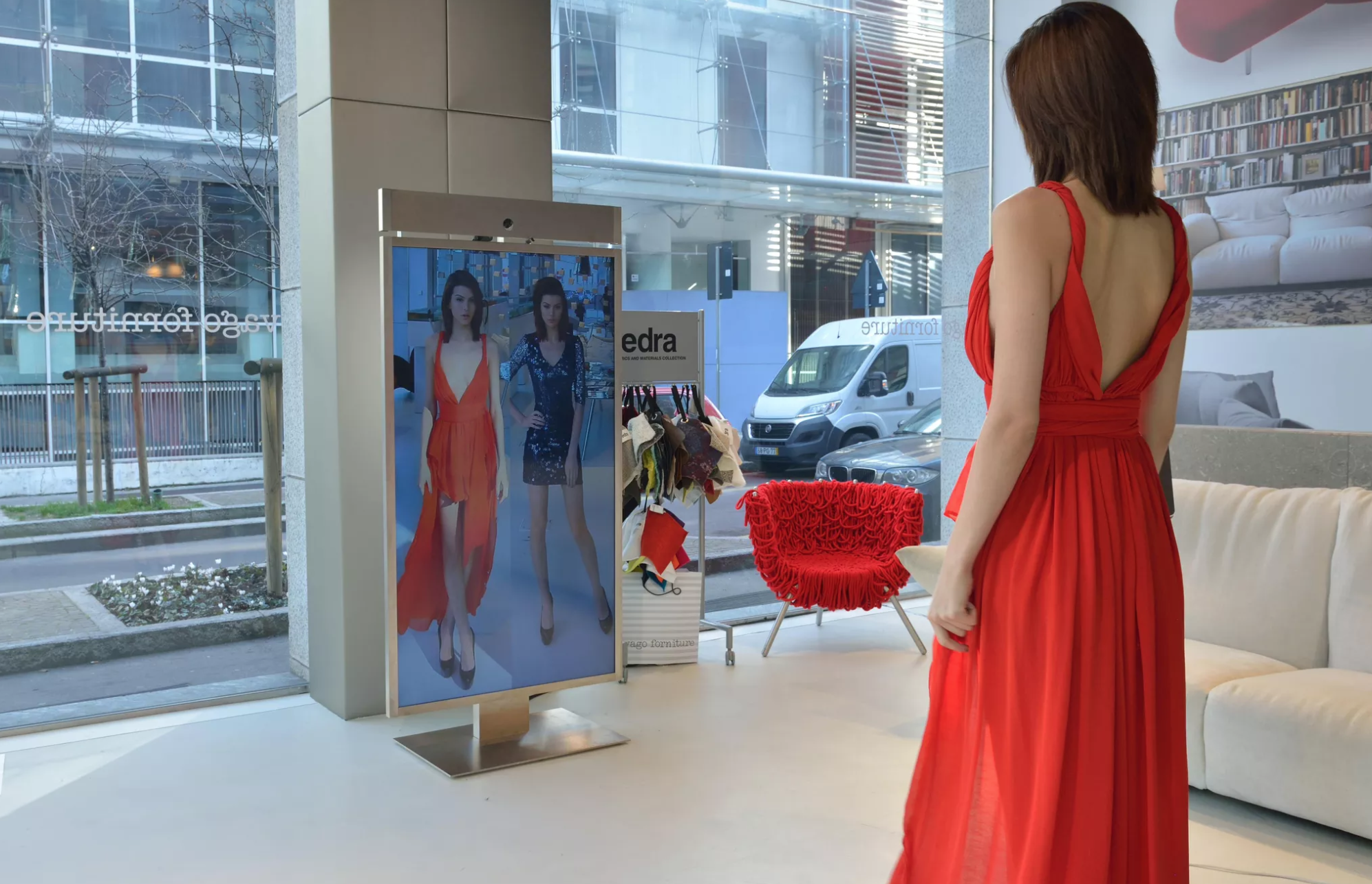 Woman looks into digital mirror