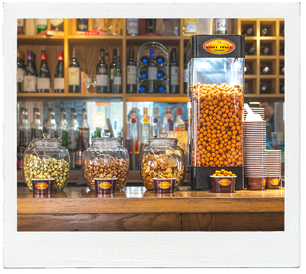 Hot nut machine with jars on bar