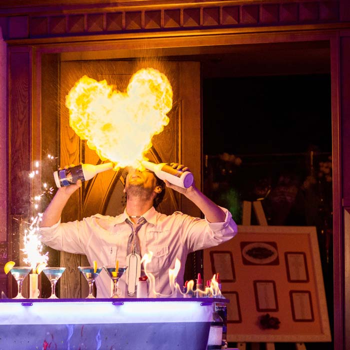 a fire juggler performing corporate event entertainment
