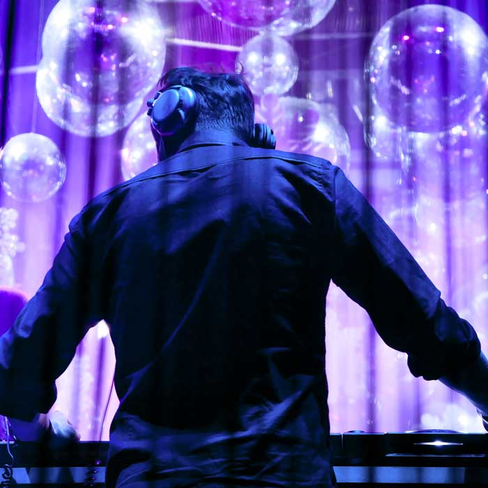 A Corporate DJ entertaining guests at an event