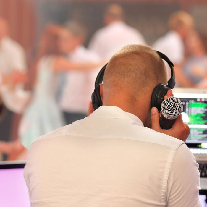 perth wedding DJ cueing up another wedding song