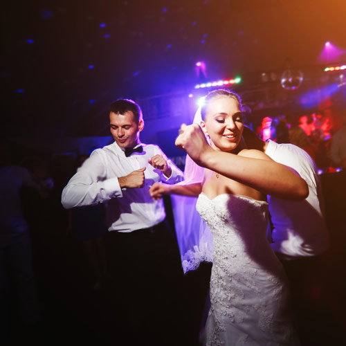 bride is dancing and having fun with music played by a wedding dj for hire
