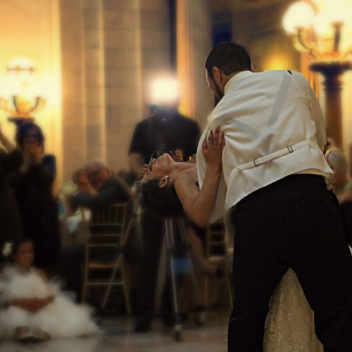 a couple dancing romantically at a wedding