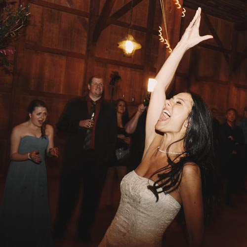 bride dancing to the best wedding reception songs