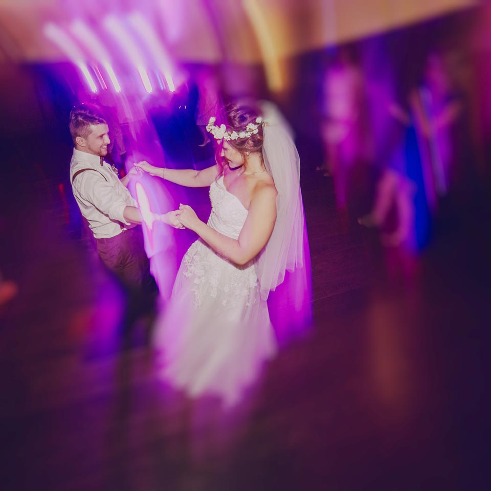 a lovely couple at a wedding dancing to the music of a wedding DJ