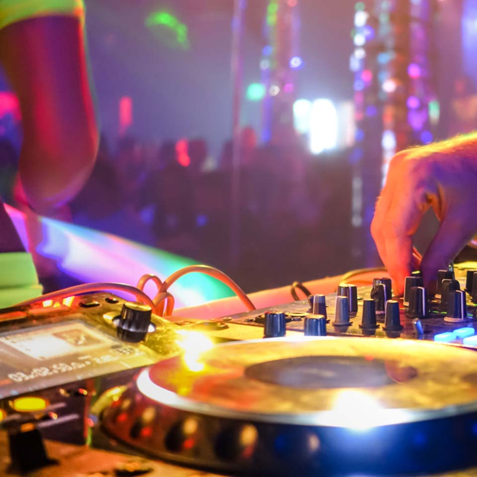 view of a corporate entertainer using DJ equipment