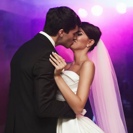 young couple kissing on their first dance