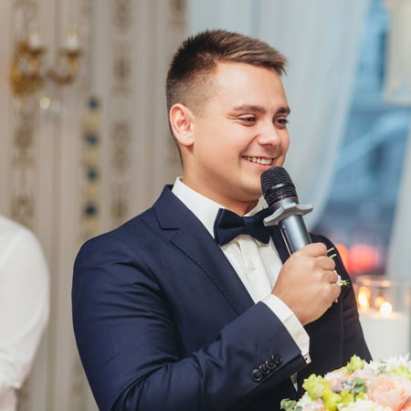 a wedding dj and mc with a microphone