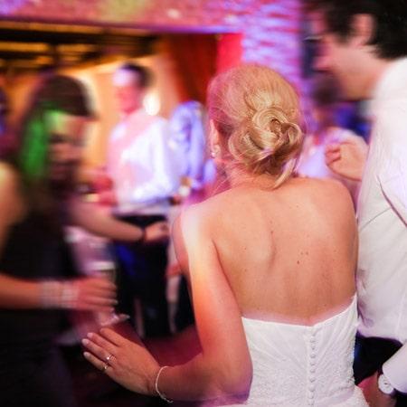 a couple enjoying their wedding reception entertainment