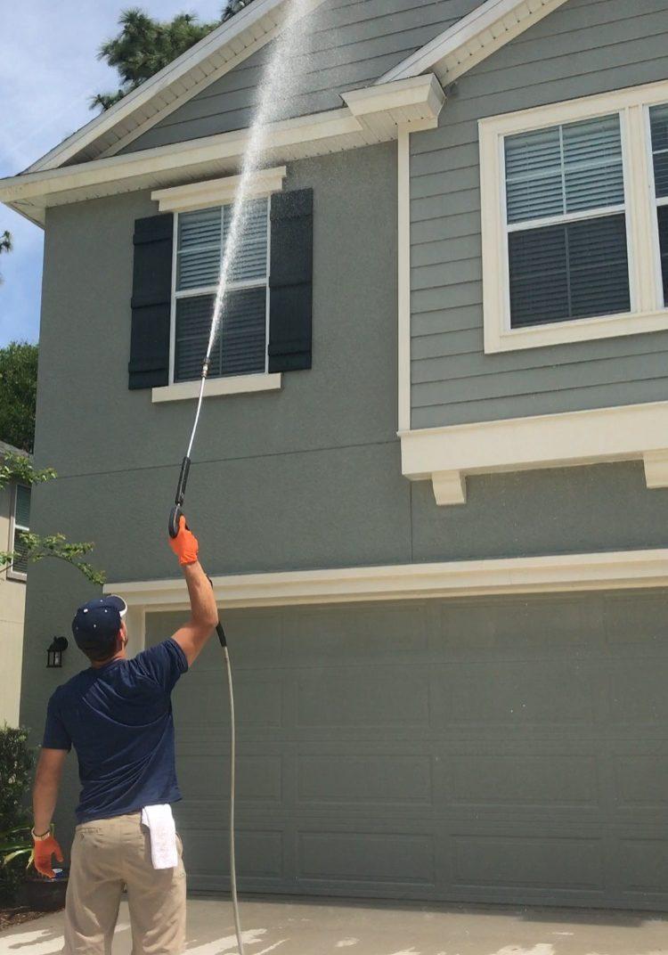 Pressure washing a home