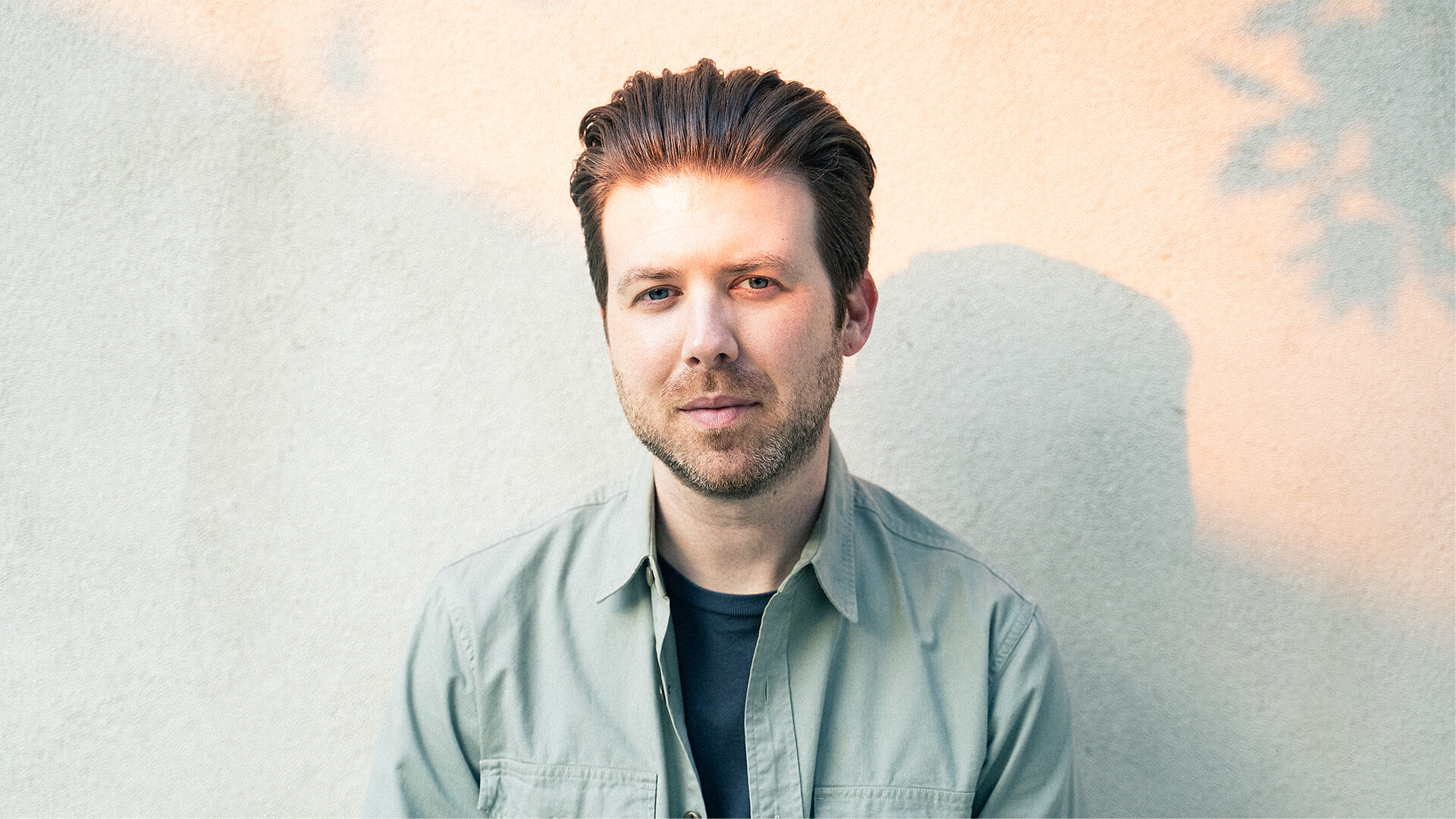 Photo of illustrator, designer and animator, Greg Gunn, in his studio